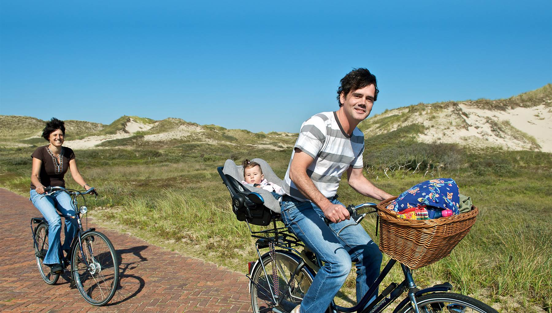 Amsterdam Family cycling in dunes Rob Verhagen