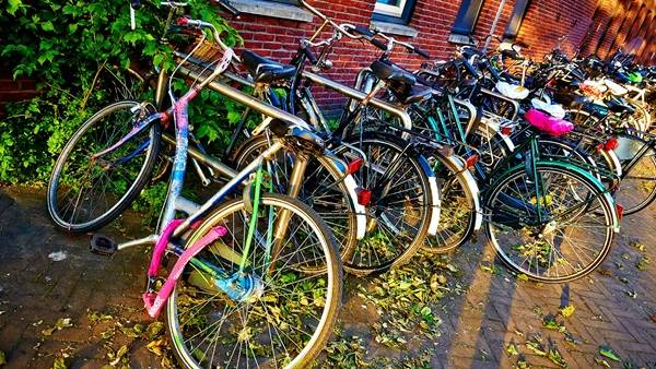 Amsterdam bikes in bike rack CC BY-ND 2.0 Moyan Brenn via Flickr