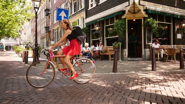 Girl on bike Amsterdam CC BY-SA 2.0 Franklin Heijnen via Flickr
