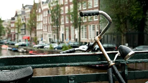 Amsterdam canal and bike rain Pablo CC BY-SA 2.0 via Flickr