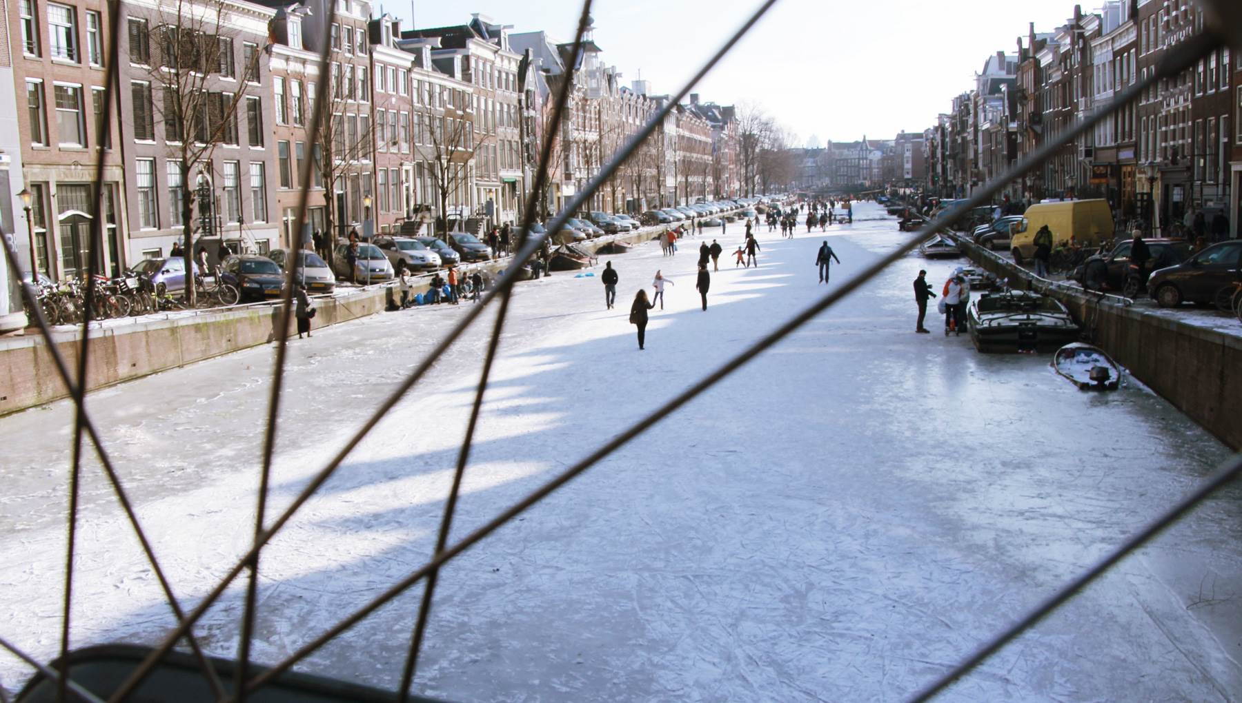 Amsterdam winter canal ice skating Toyah Boer