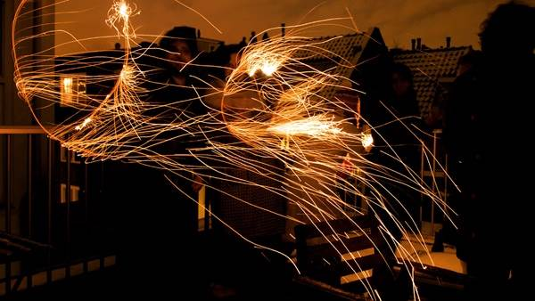 Amsterdam New Years Eve sparklers, CC BY 2.0 Thomas Ricker via Flickr